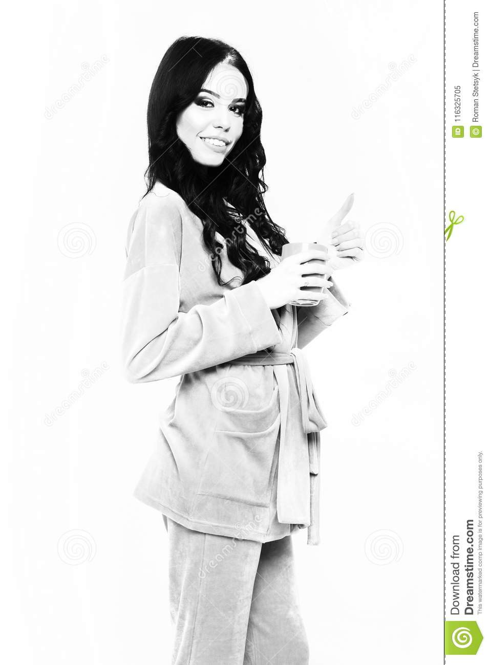 Pretty cute girl or beautiful woman with fashion makeup on smiling happy  face and curly long hair posing in womans pink velour pajama home suit with  cup ... 4e83b252a
