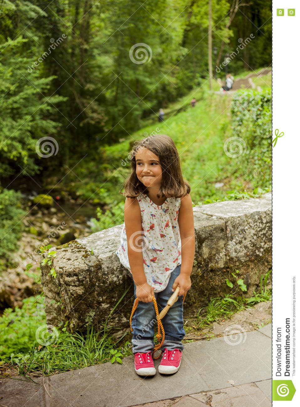 Smiling girl posing at the lakes in Covadonga, Asturias