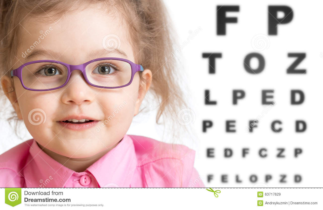 Smiling girl putting on glasses with blurry eye