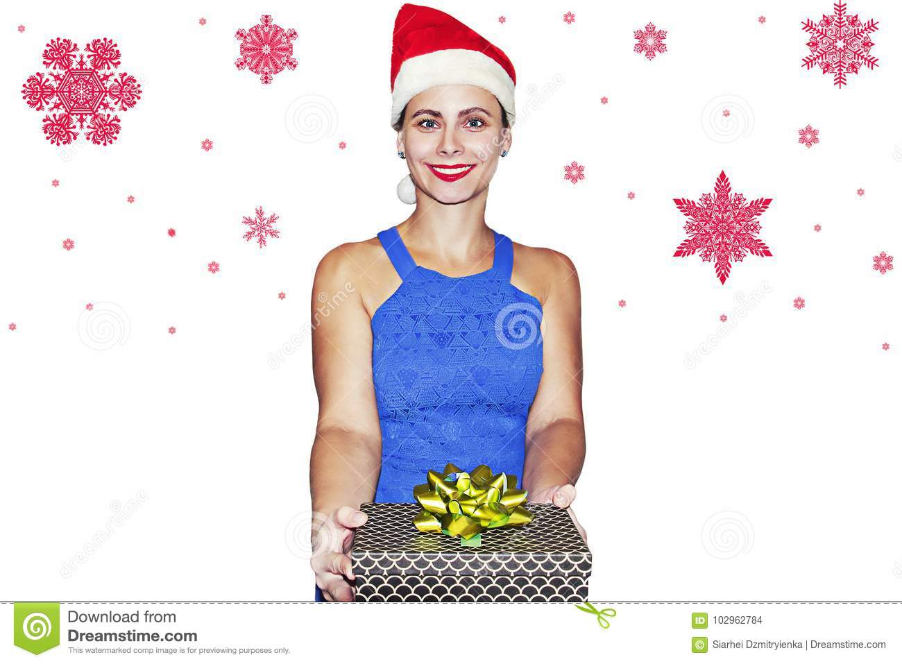 Smiling girl in Santa Claus hat with gift box in hand on white background with red snowflakes