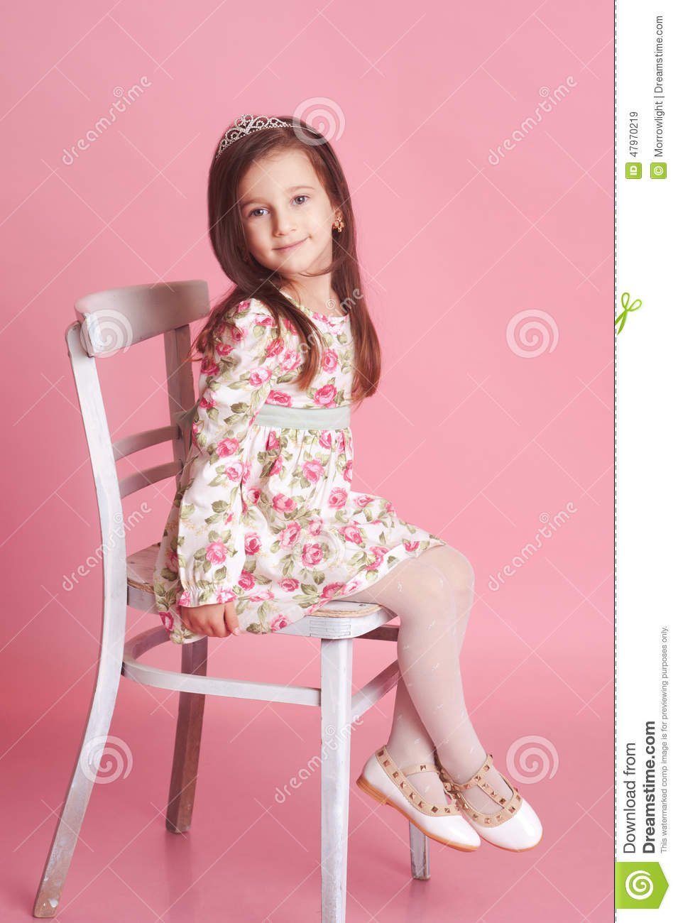 smiling girl sitting on chair in room stock image image. Black Bedroom Furniture Sets. Home Design Ideas