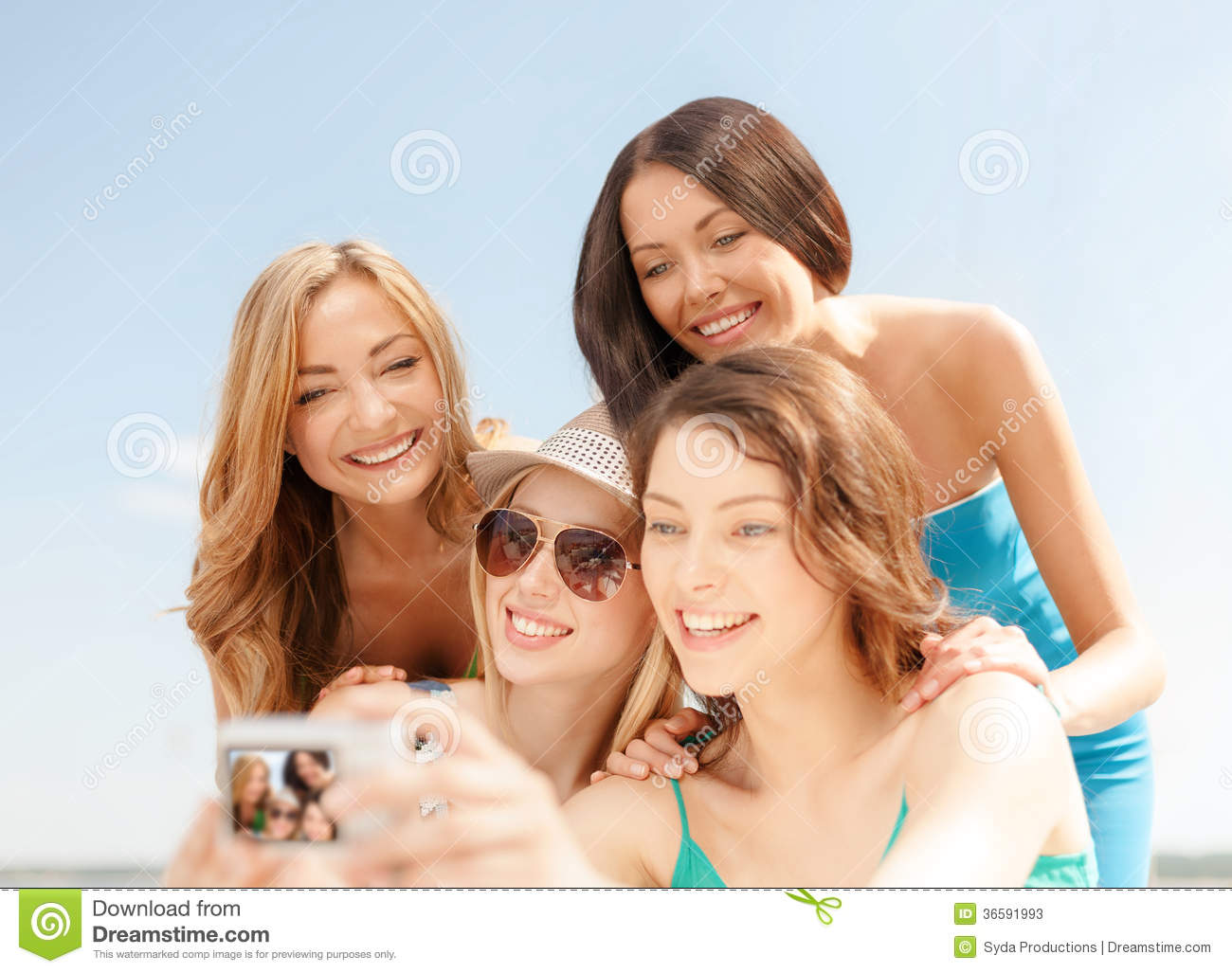 Smiling Girls Taking Photo In Cafe On The Beach Stock Image