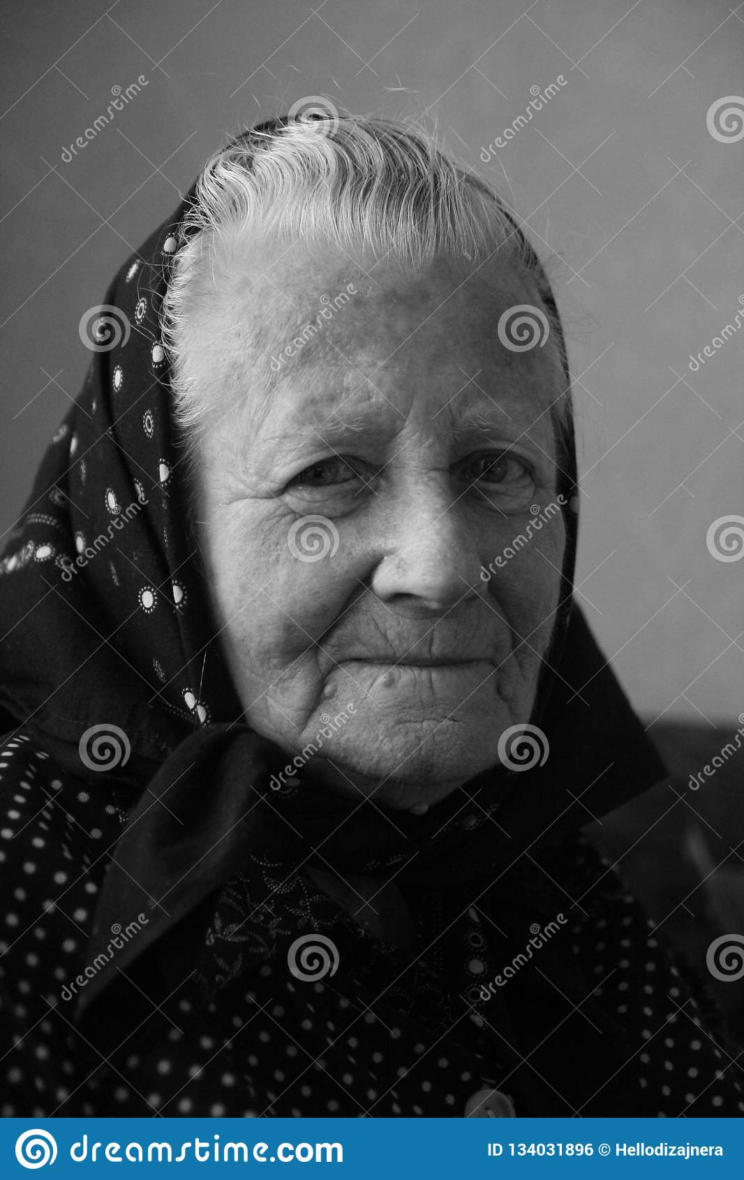 Smiling middle european grandmother old woman senior face artistic black and white portrait