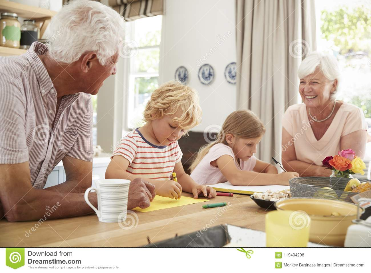 Smiling grandparents with grandkids in the kitchen, close up