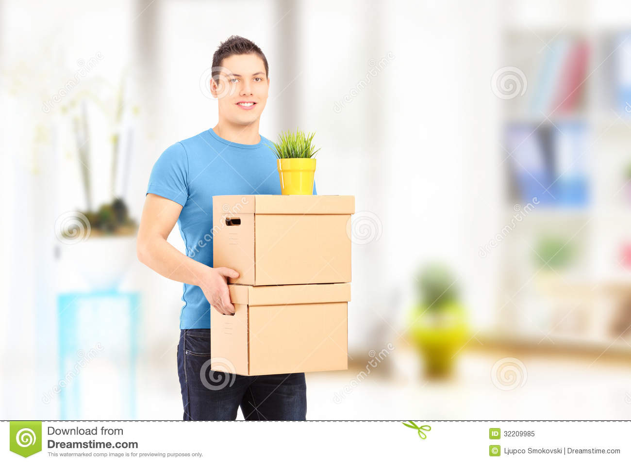 Smiling Guy Carrying Removal Boxes During Moving Royalty Free