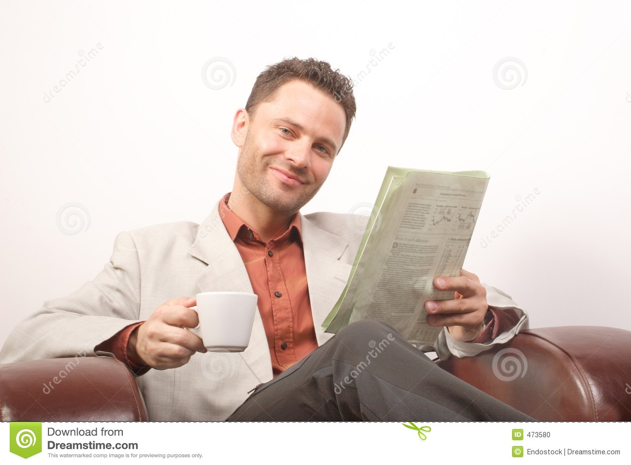 Smiling Handsome Man Newspaper Cup Of Coffee Stock Photo