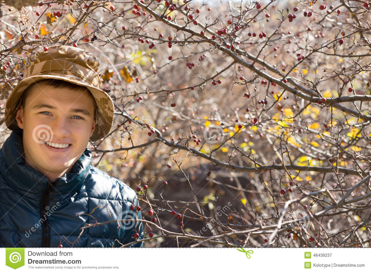 Smiling handsome young man outdoors in woodland
