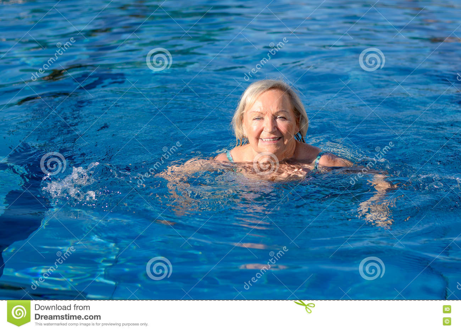 Smiling happy active elderly woman