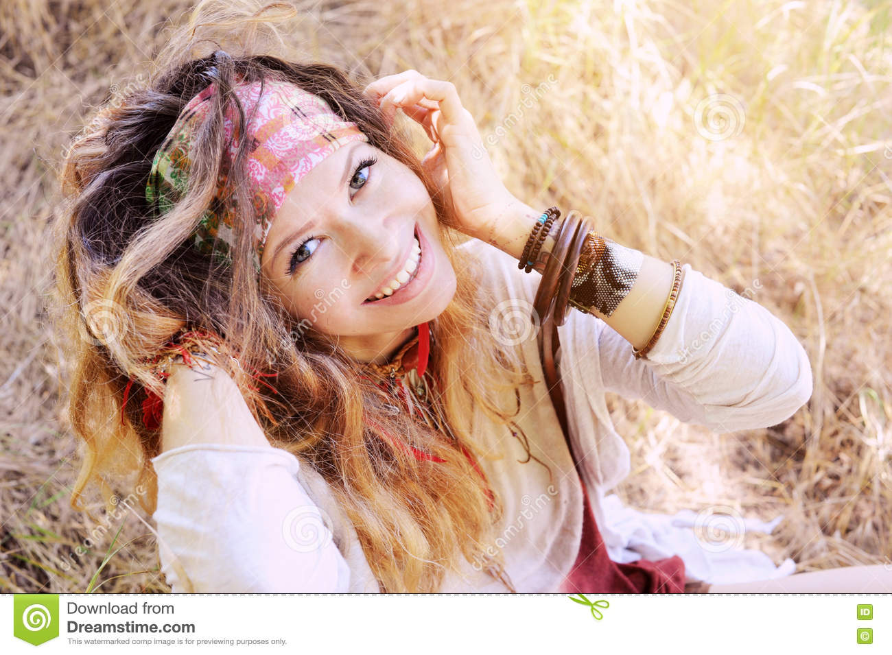 Smiling happy hippie woman outdoor portrait, looking at camera