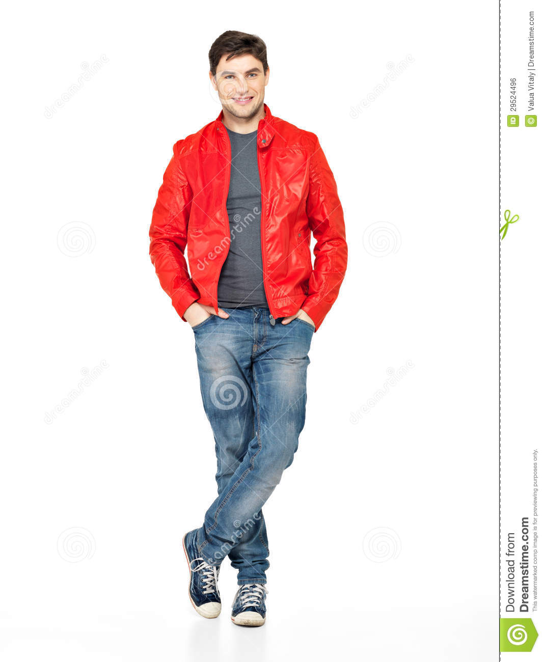 Smiling Happy Man In Red Jacket Blue Jeans And Gymshoes