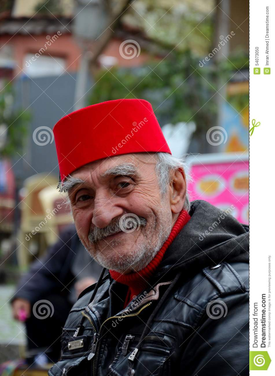 Smiling Happy Old Turkish Man In Fez And Leather Jacket