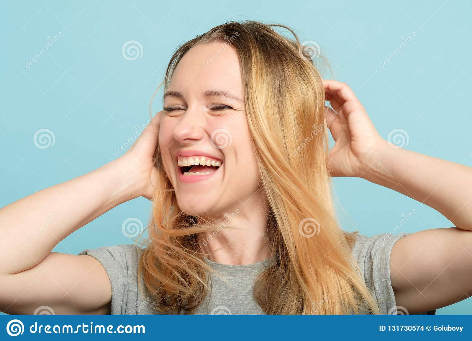 Happy woman playing hair beauty confidence