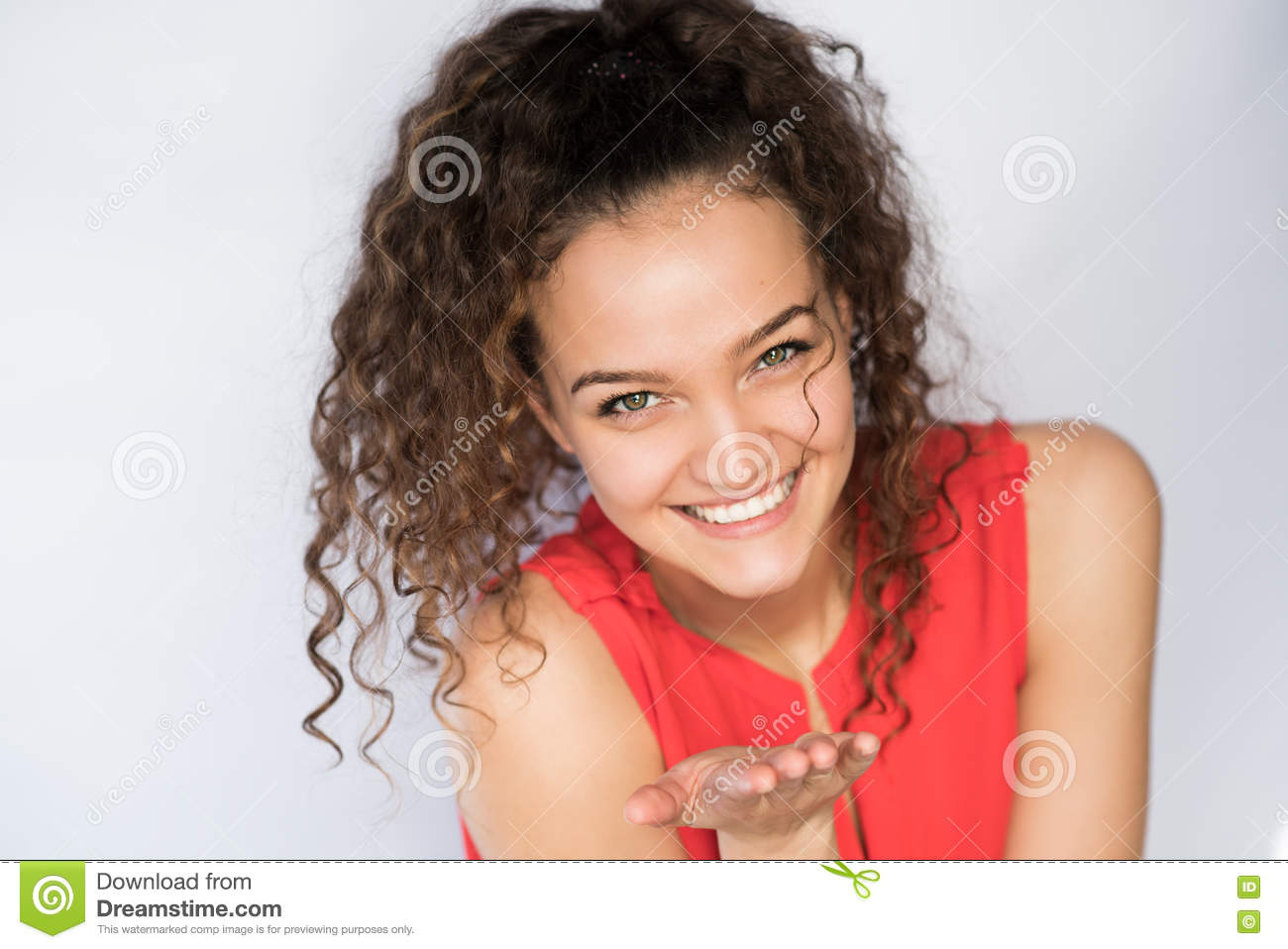 Smiling And Happy Young Woman Look At One Side With Curly Hair Stock