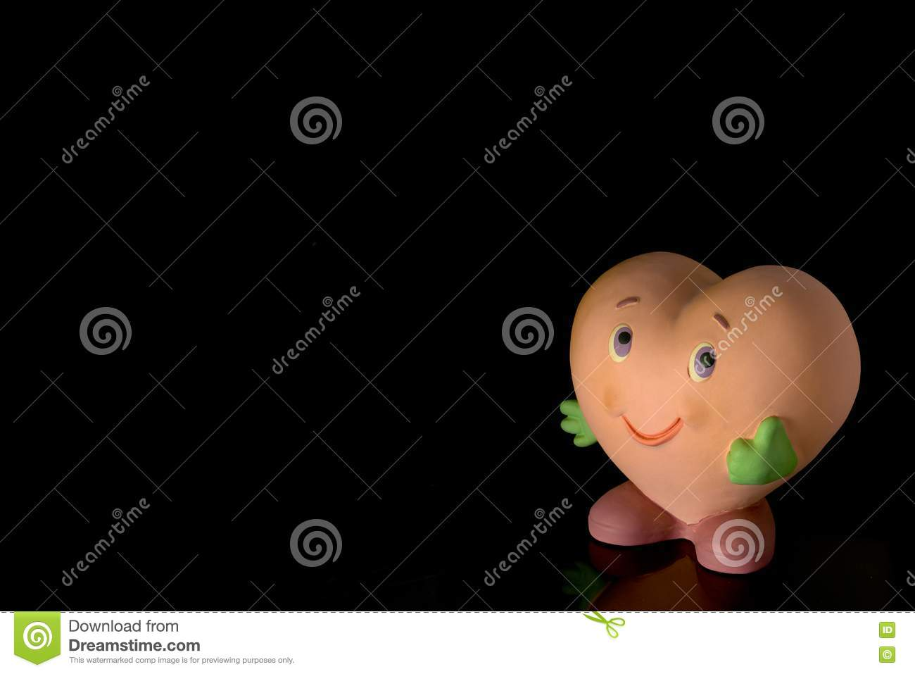 Smiling heart-shaped doll