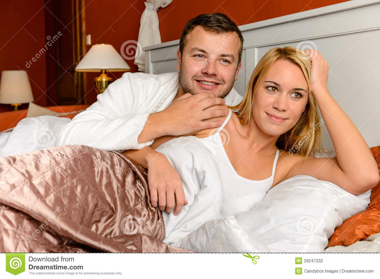 Smiling Husband Holding Wife Lying Bed Married Stock