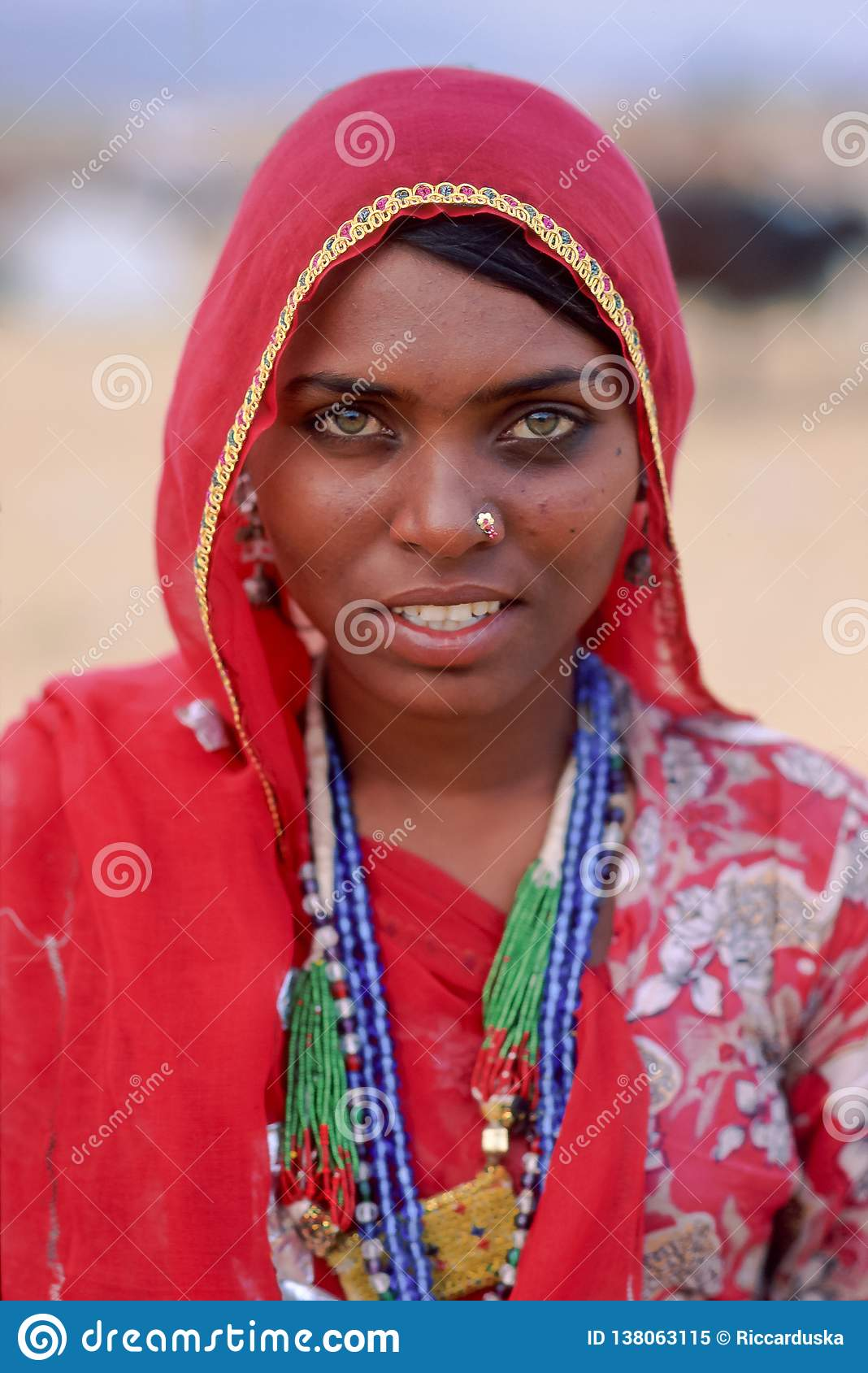 A smiling indian woman dressed in traditional Rajasthani clothing at Pushkar Camel Fair, North Western India