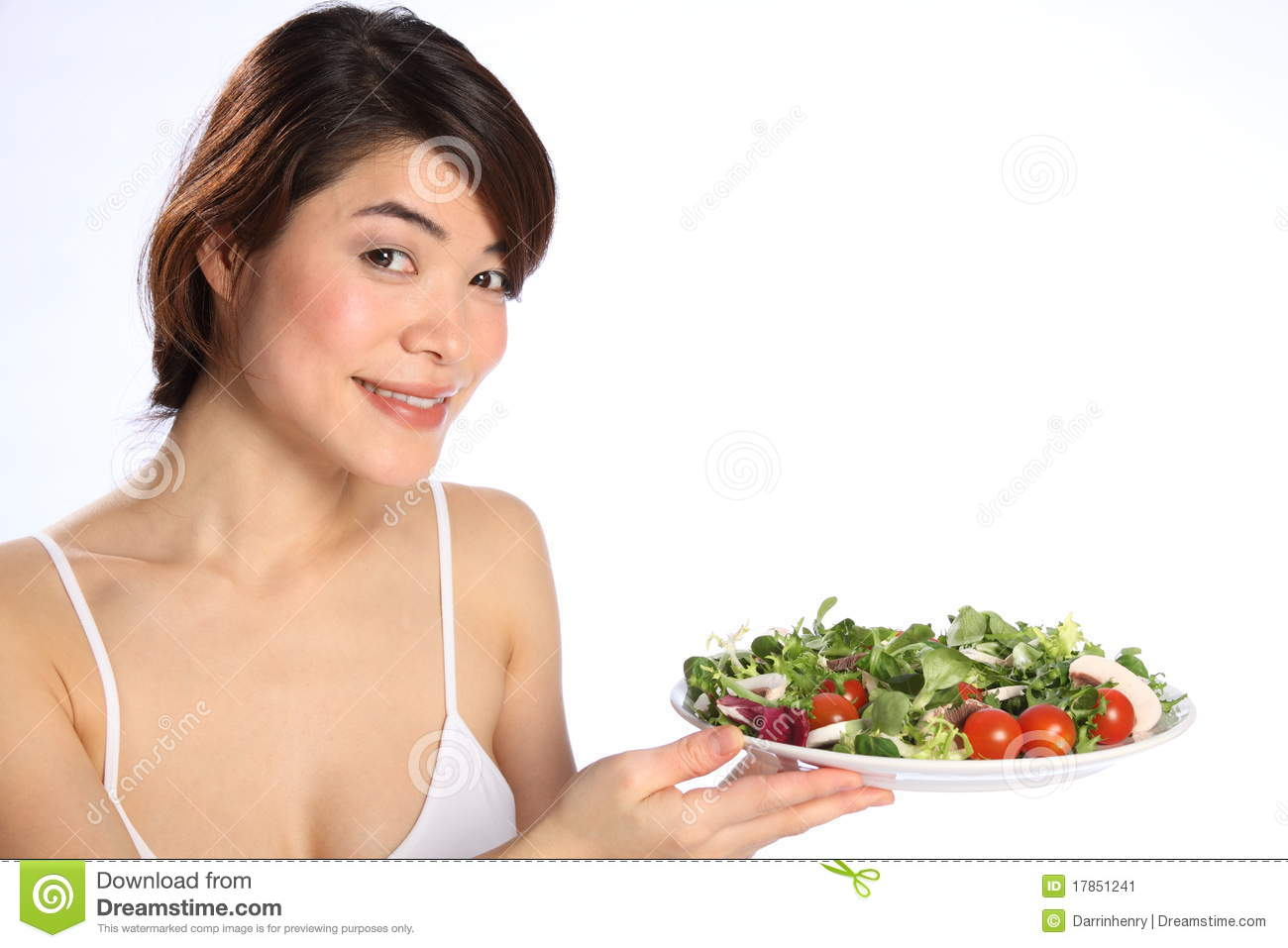 Smiling Japanese Girl Holds Out Plate Green Salad Royalty