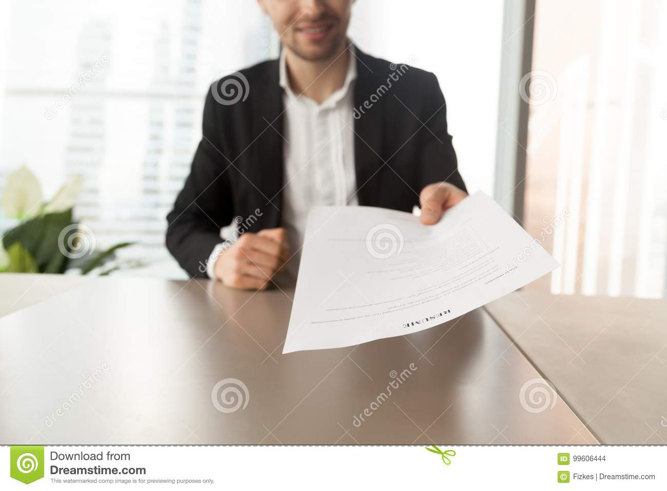 Smiling Job Applicant Handing Over Resume To Recruiter During In