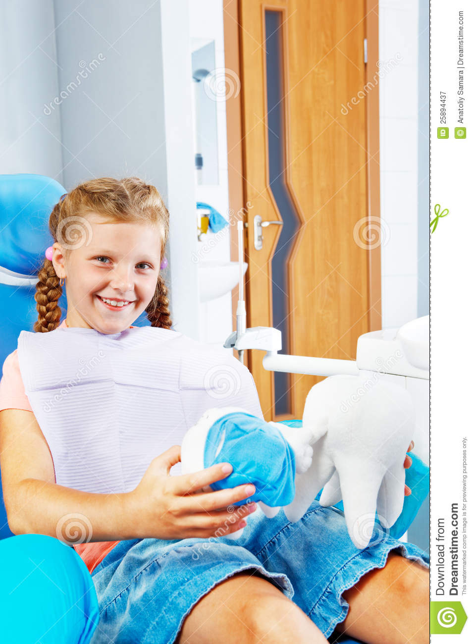 Smiling kid in a dentist chair royalty free stock photography image