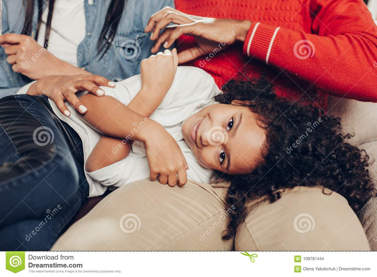Download Smiling Kid Reposing On Parents Knees Stock Photo - Image of child, african: 109781444