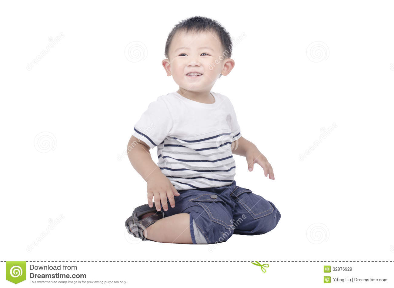 Smiling Kid Sit On The Floor Royalty Free Stock Images