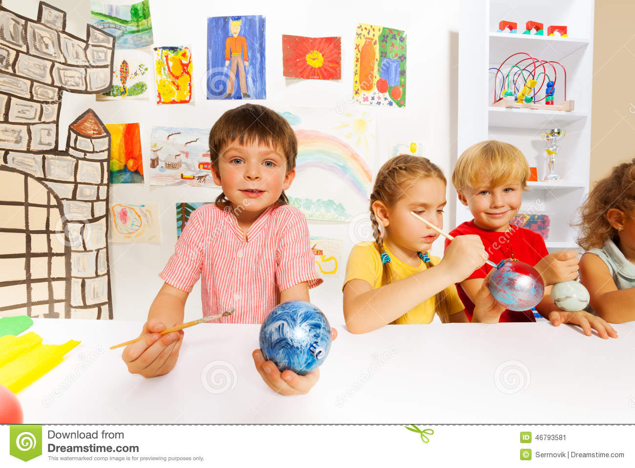 Smiling kids paint new year balls for xmas tree stock for Paintings of toddlers