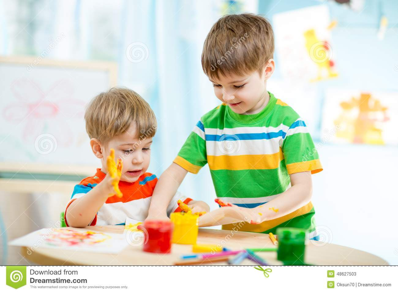Kinder Garden: Smiling Kids Play And Paint At Home Or Stock Photo
