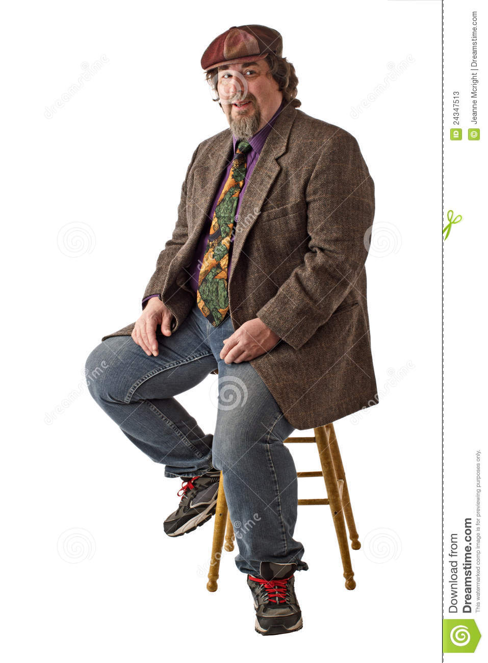 Smiling large man sits in relaxed pose