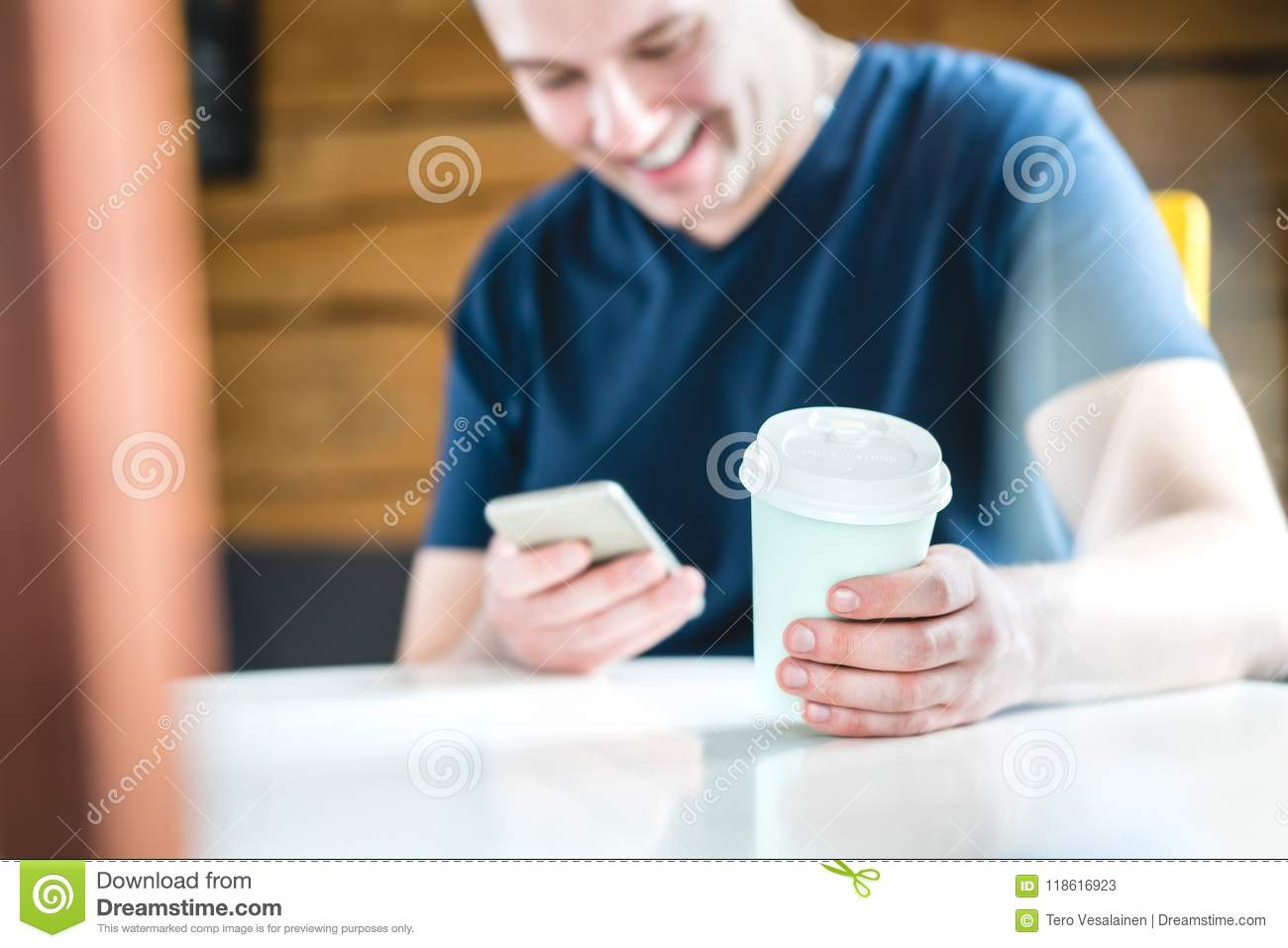 Smiling and laughing happy man using mobile phone.