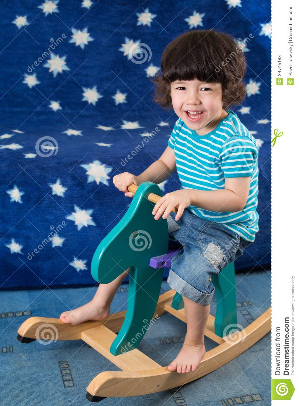 Download Smiling Little Boy Have Fun On A Toy Horse Stock Image - Image of beautiful, little: 34745183