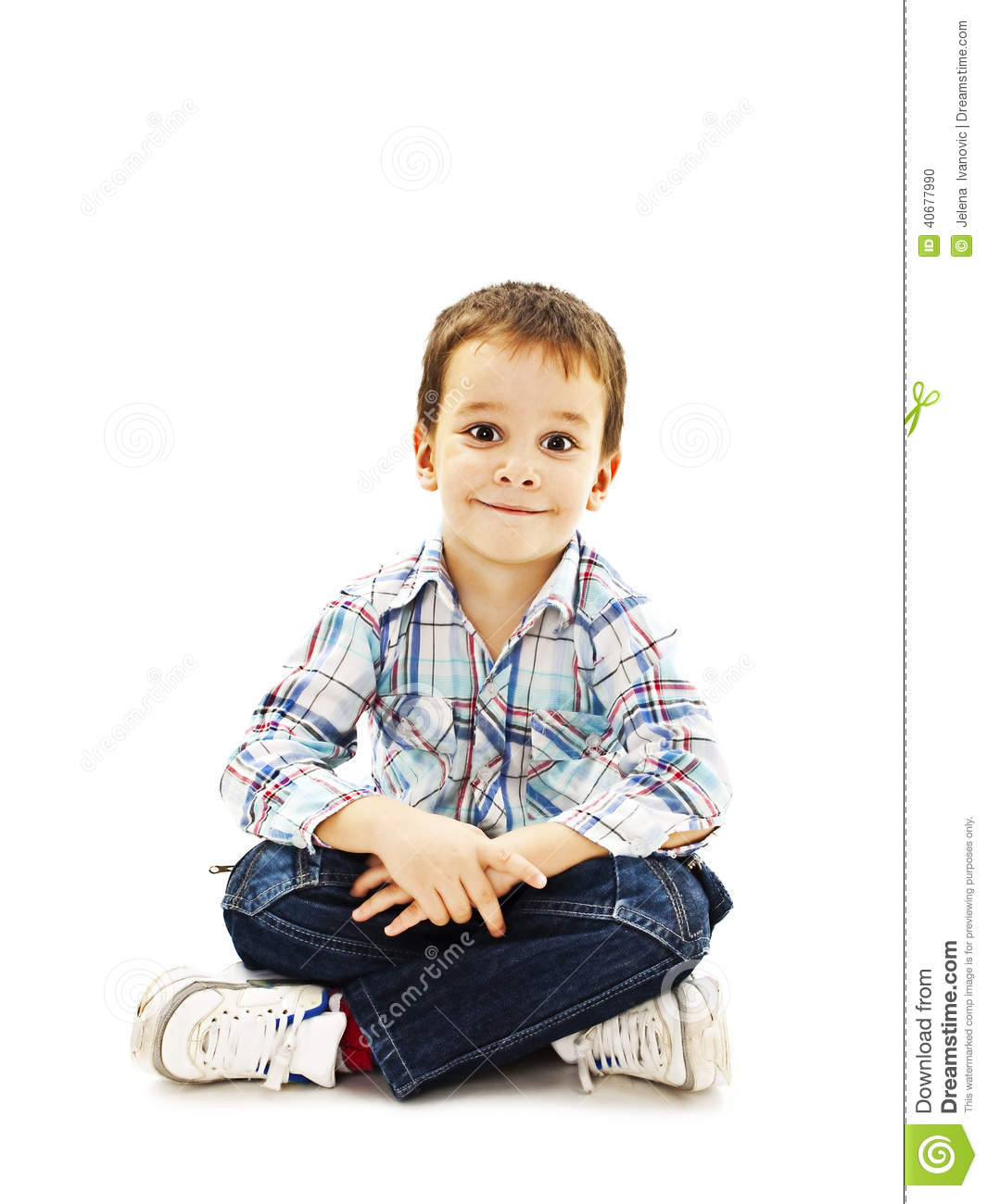 smiling little boy sitting down on floor in jeans stock photo image 40677990. Black Bedroom Furniture Sets. Home Design Ideas
