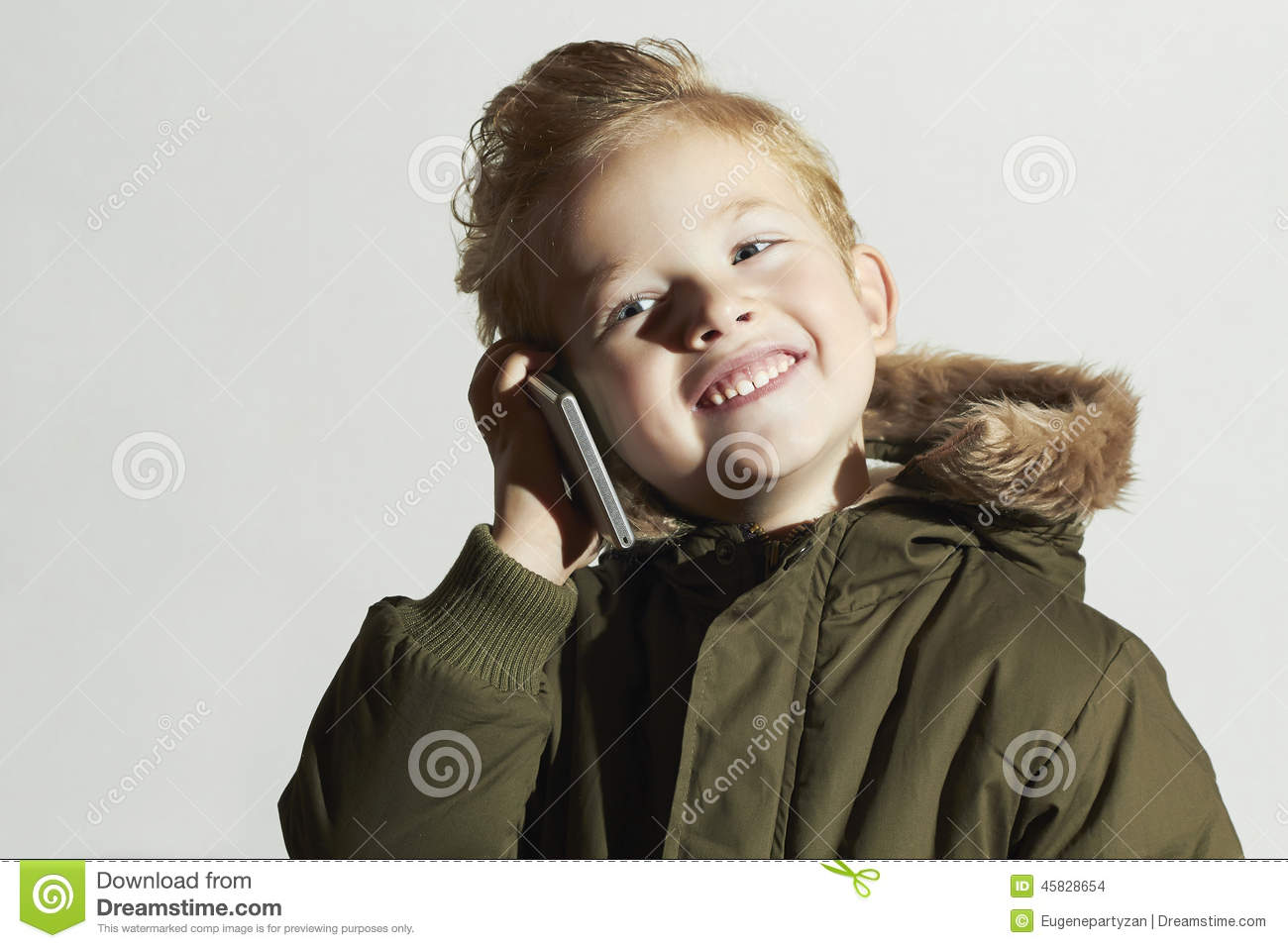 Little Boy With Cellphone Modern Child In Winter Coat