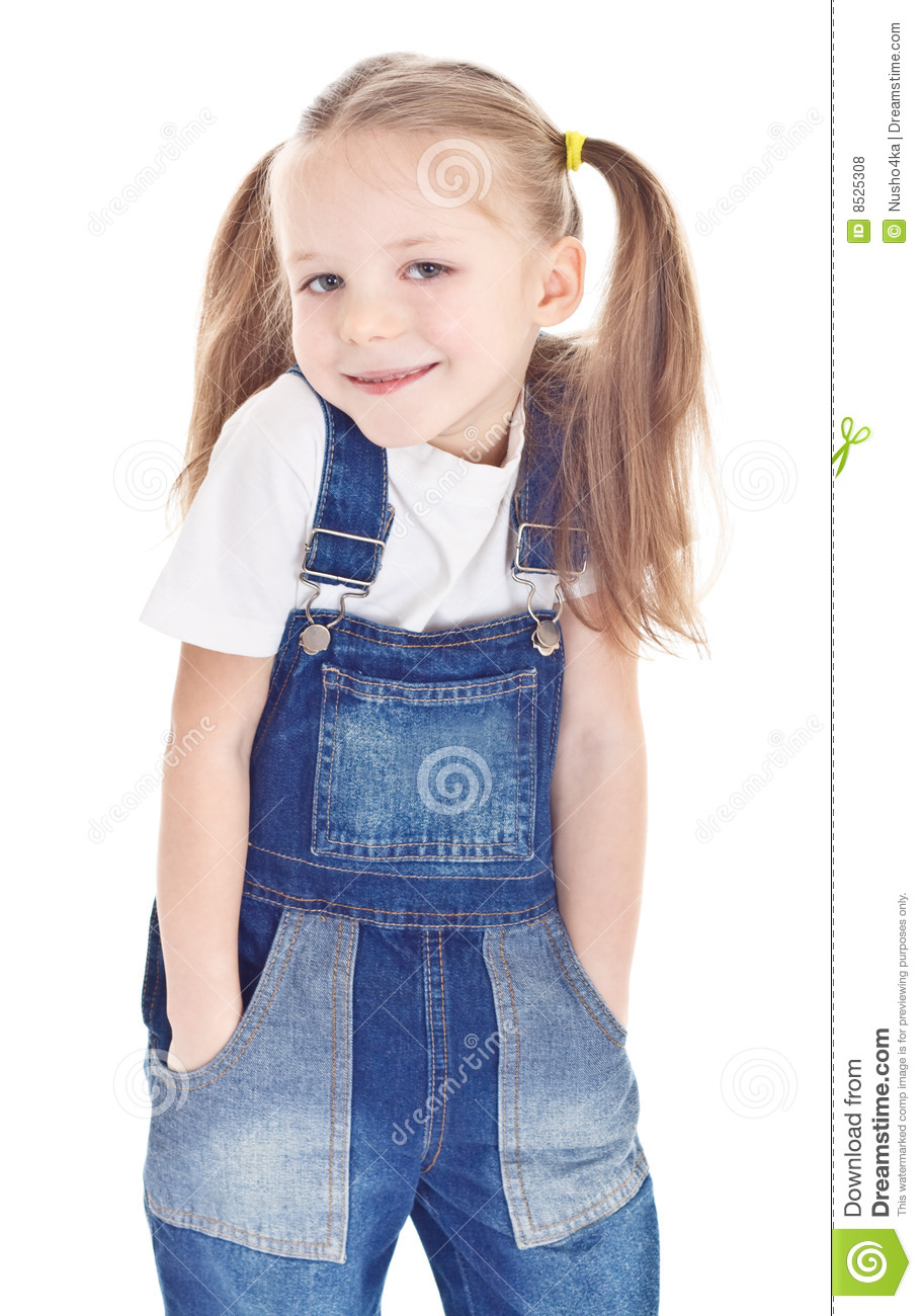 smiling little girl in blue jeans royalty free stock