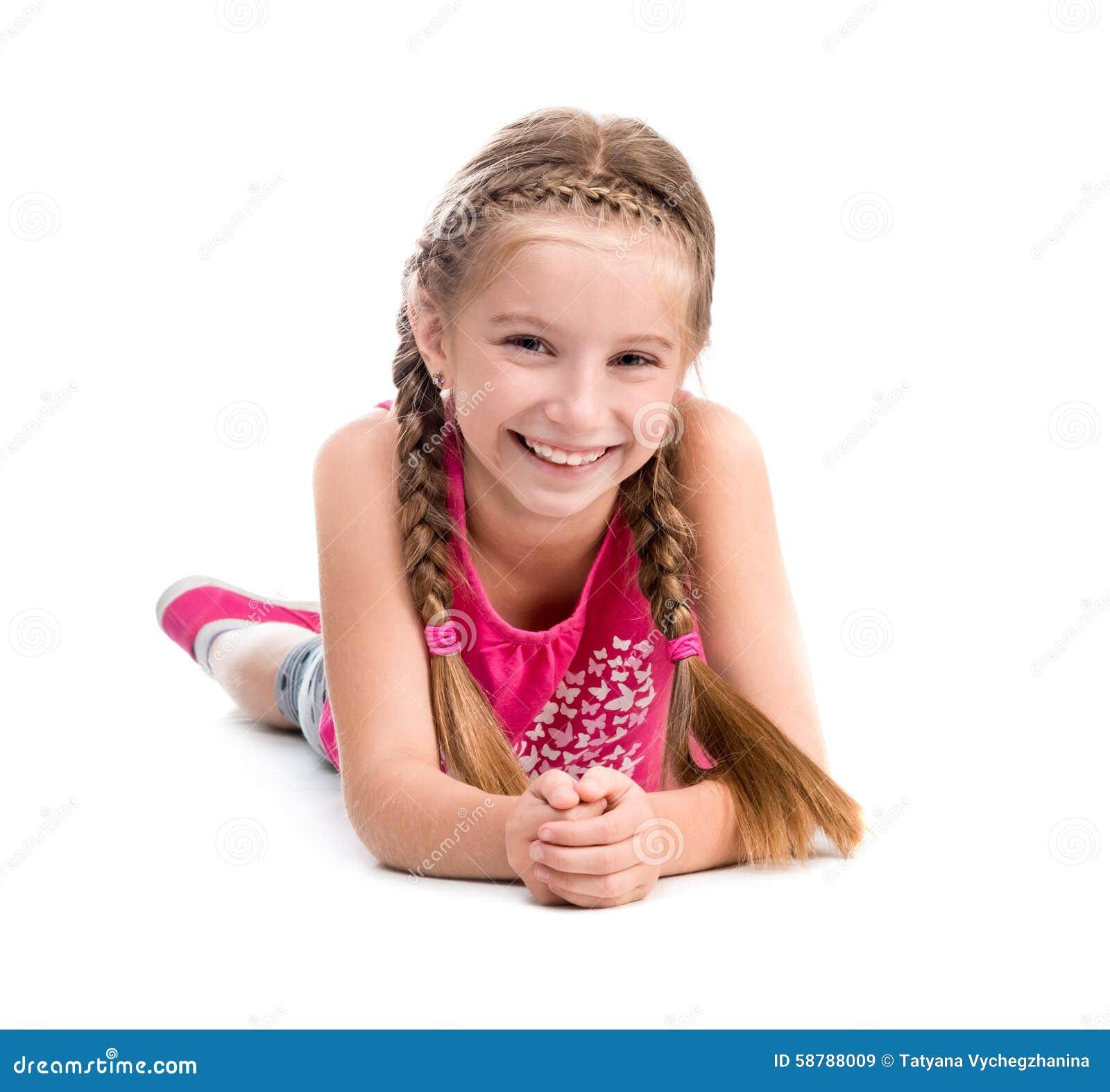Smiling little girl lying on the floor stock photo image for On the floor on the floor
