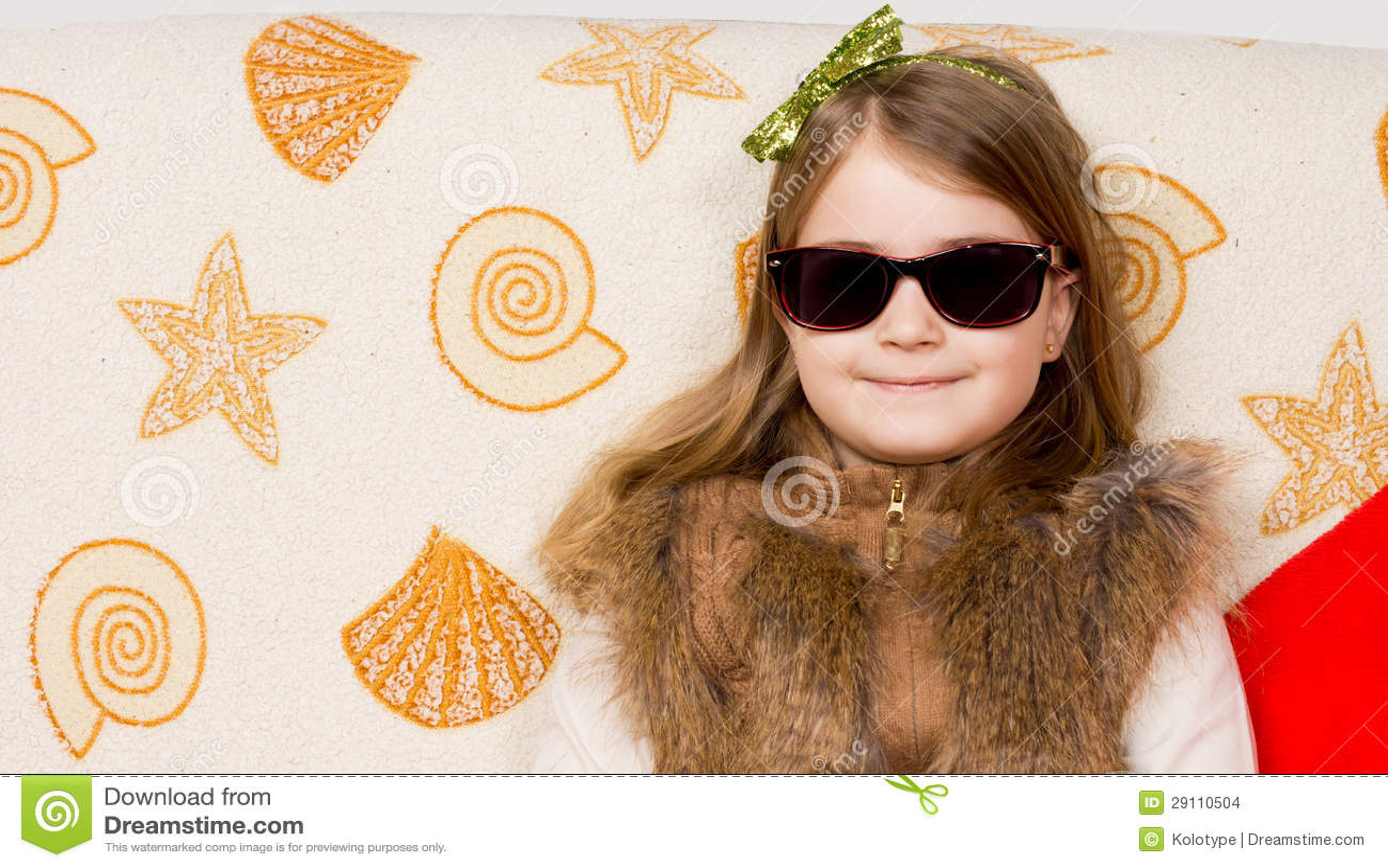 Smiling little girl in sunglasses