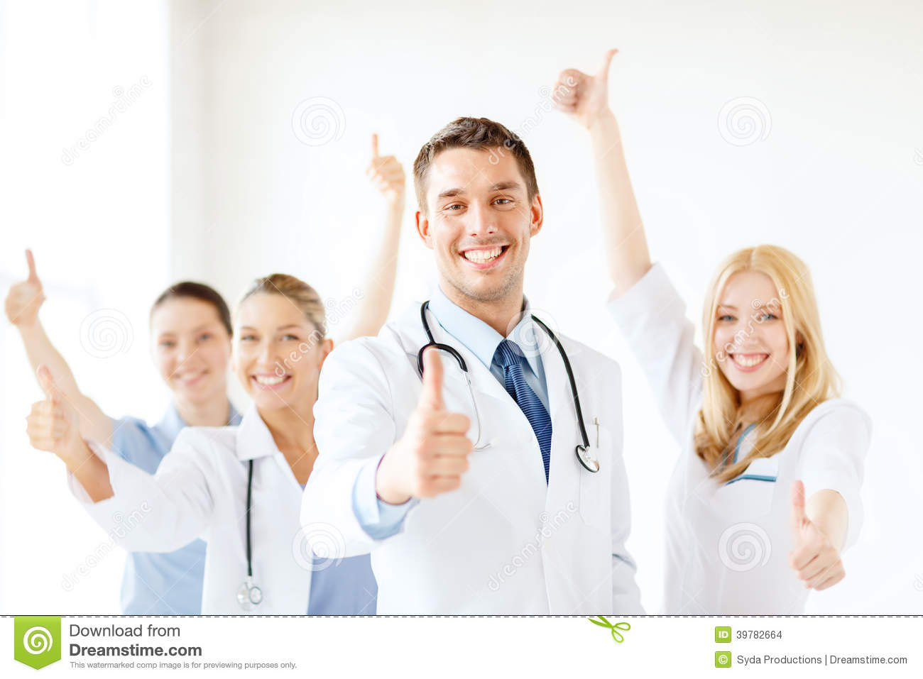 Smiling male doctor in front of medical group