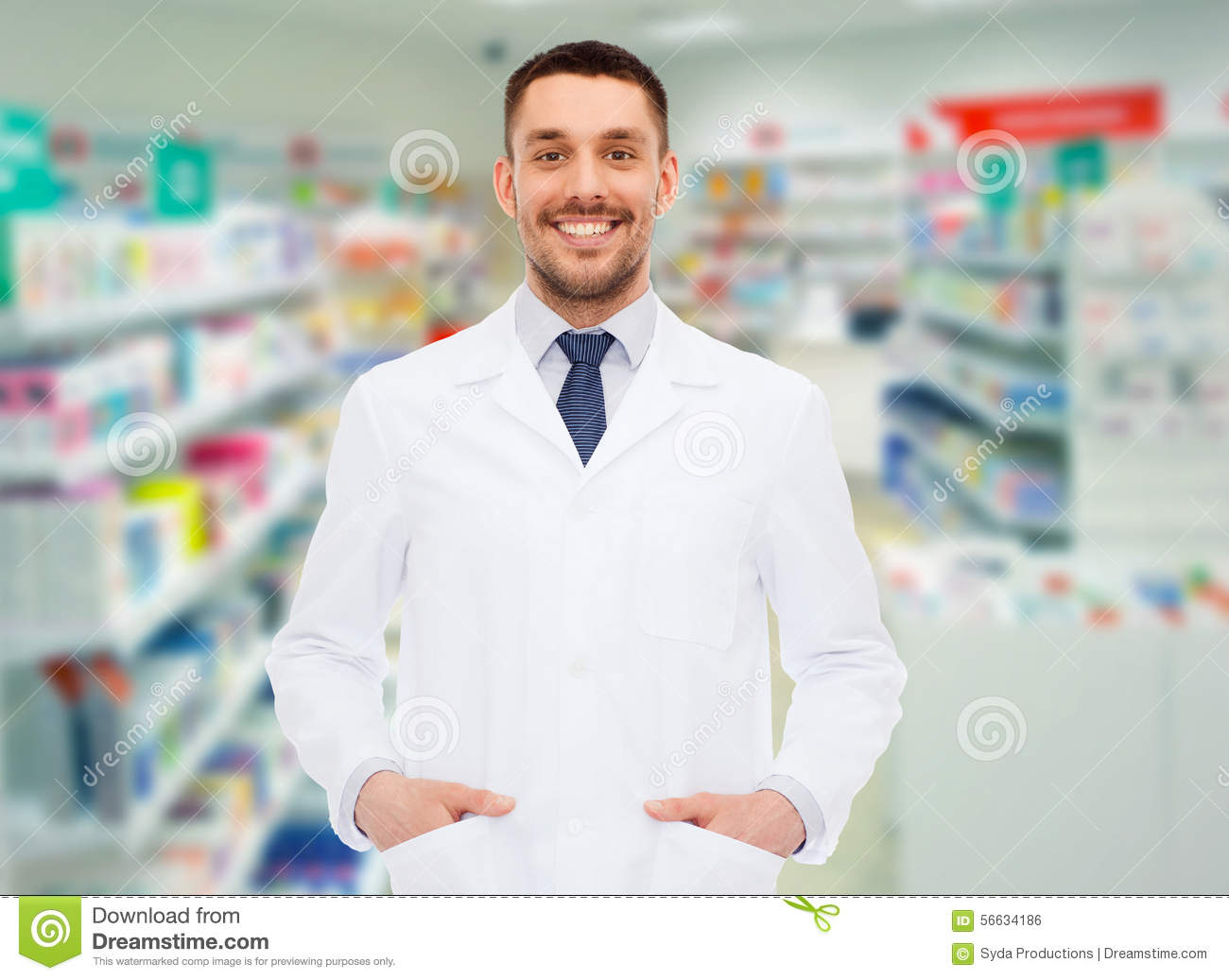 Smiling Male Pharmacist In White Coat At Drugstore Stock Photo ...