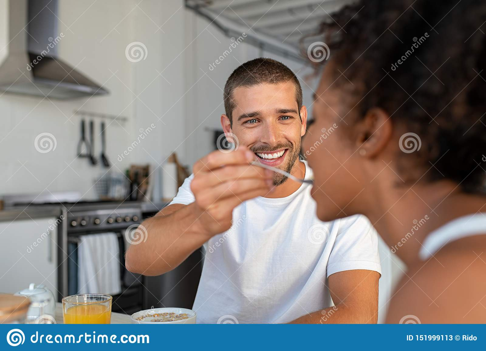 Smiling Man Feeding Breakfast To His Girlfriend Stock ...