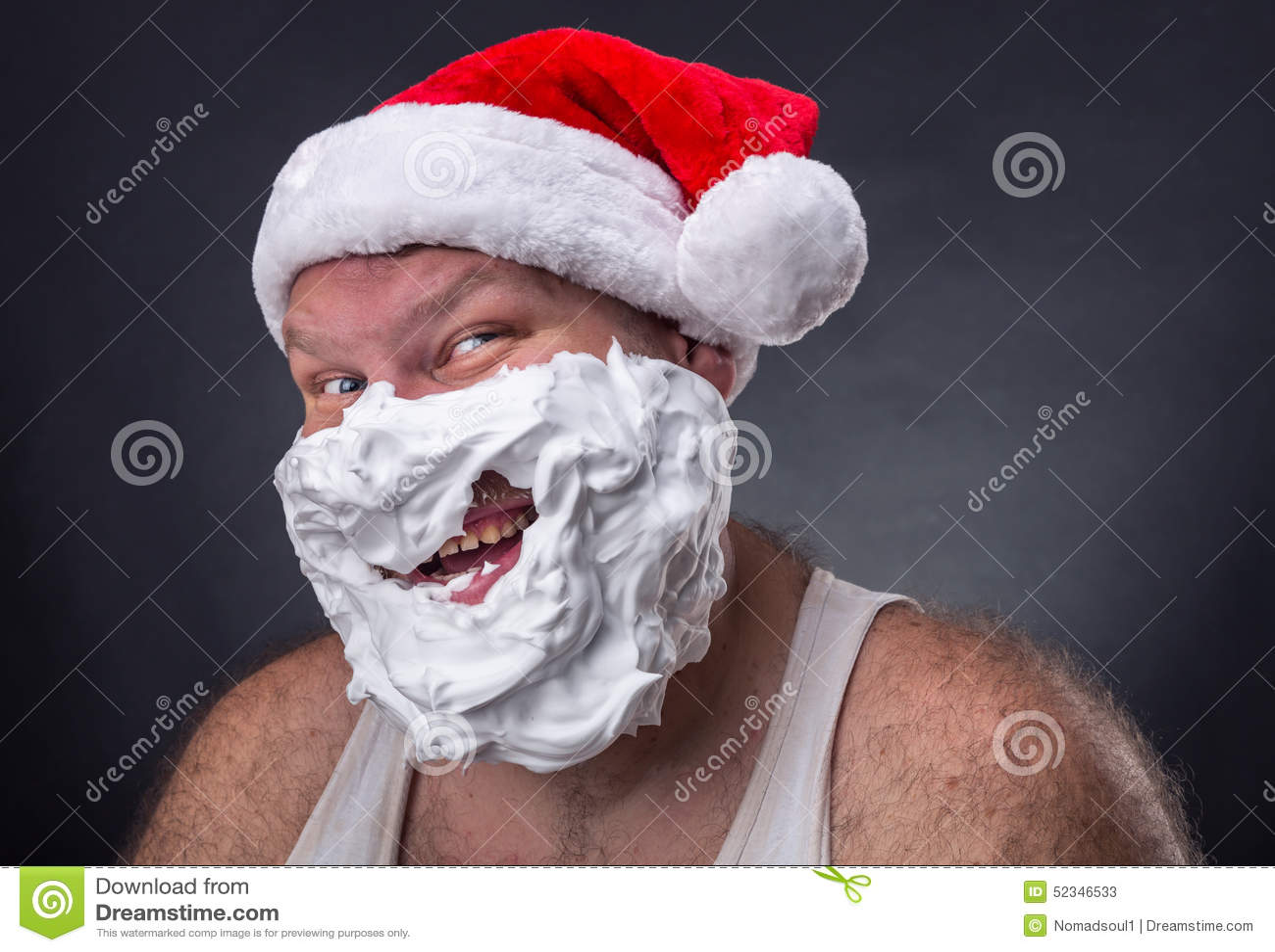 Smiling man in santa claus hat stock photo image