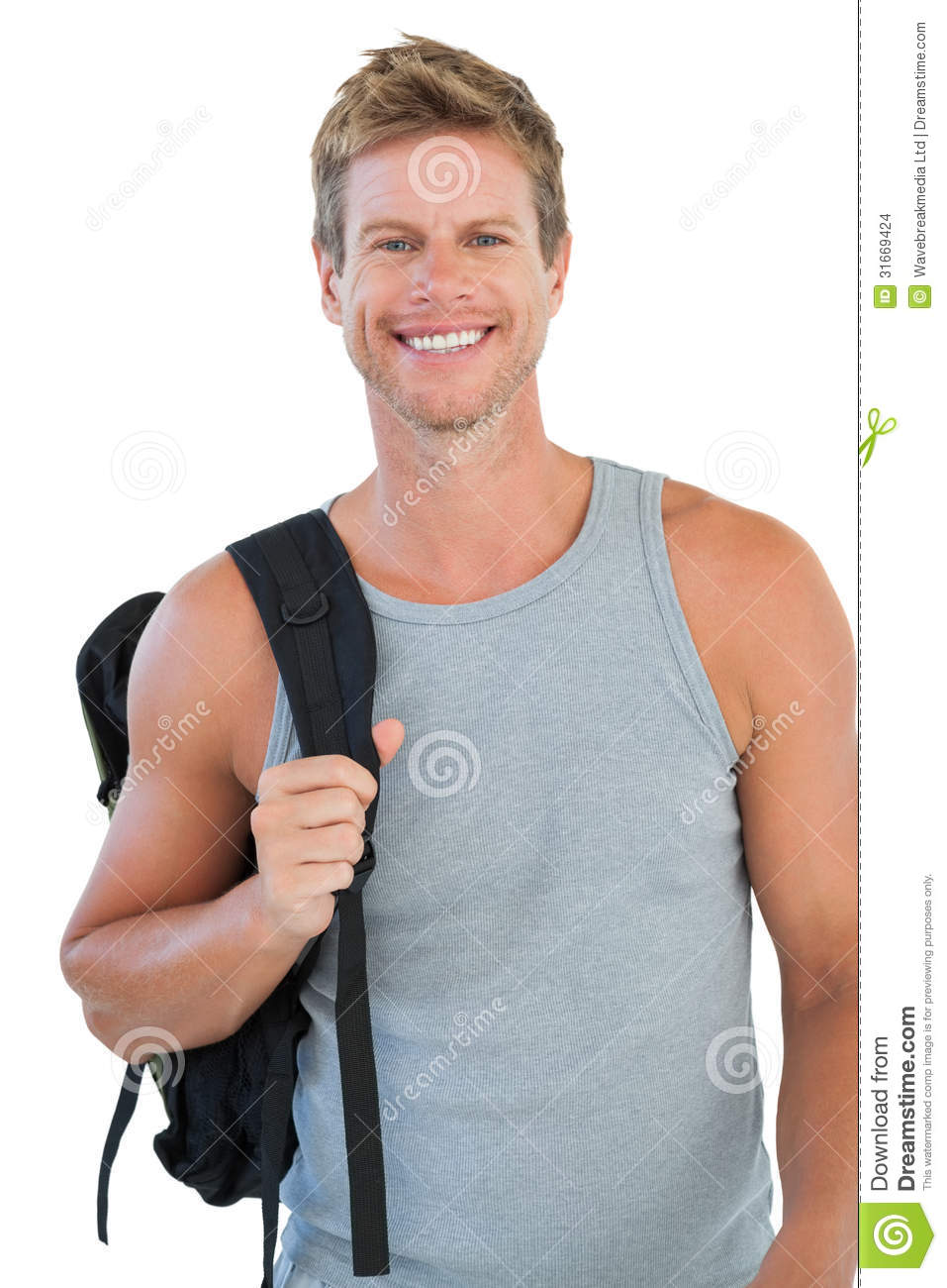 Smiling Man In Sportswear Holding Backpack Stock Photo ...