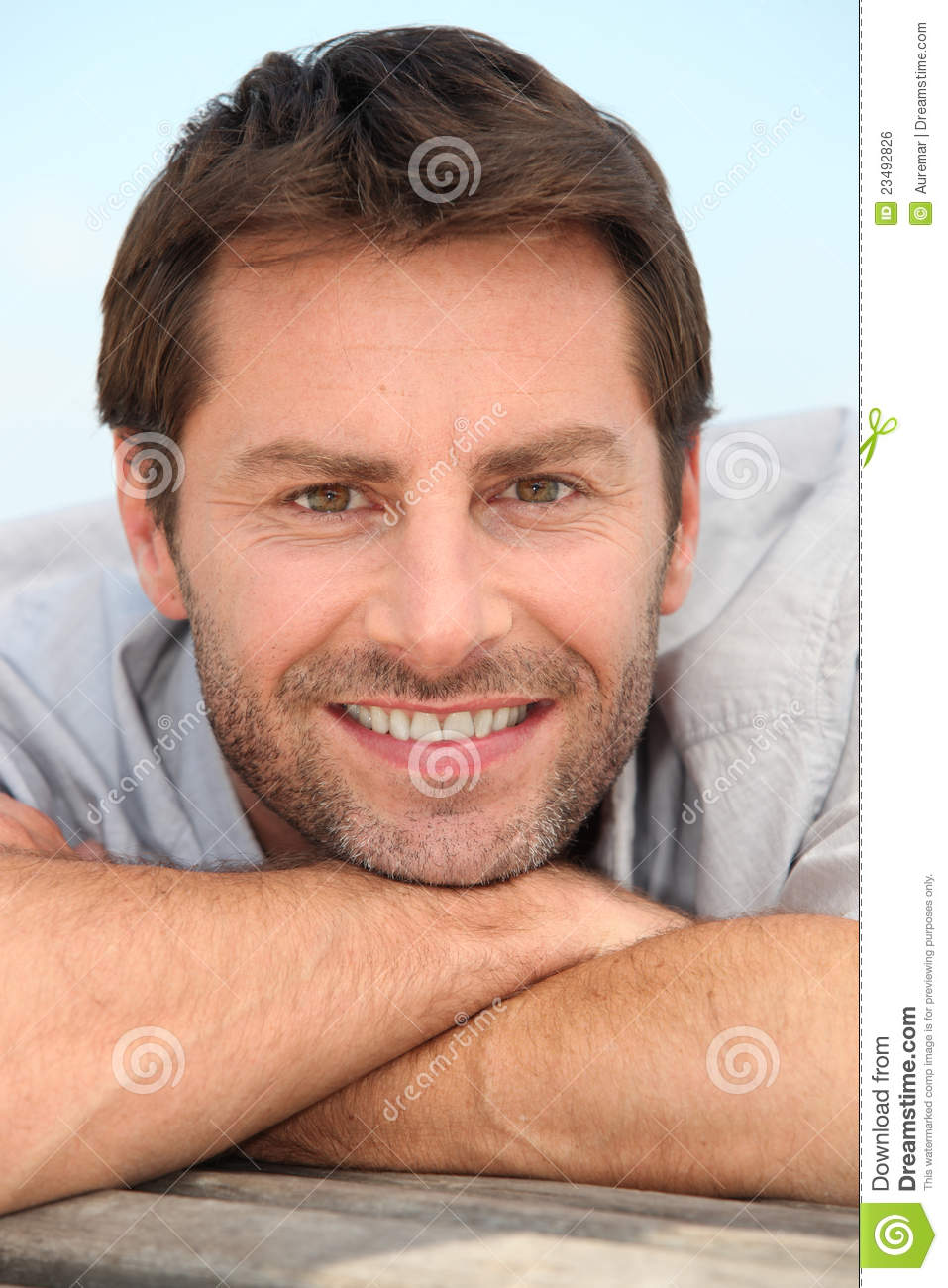 Smiling man with stubble