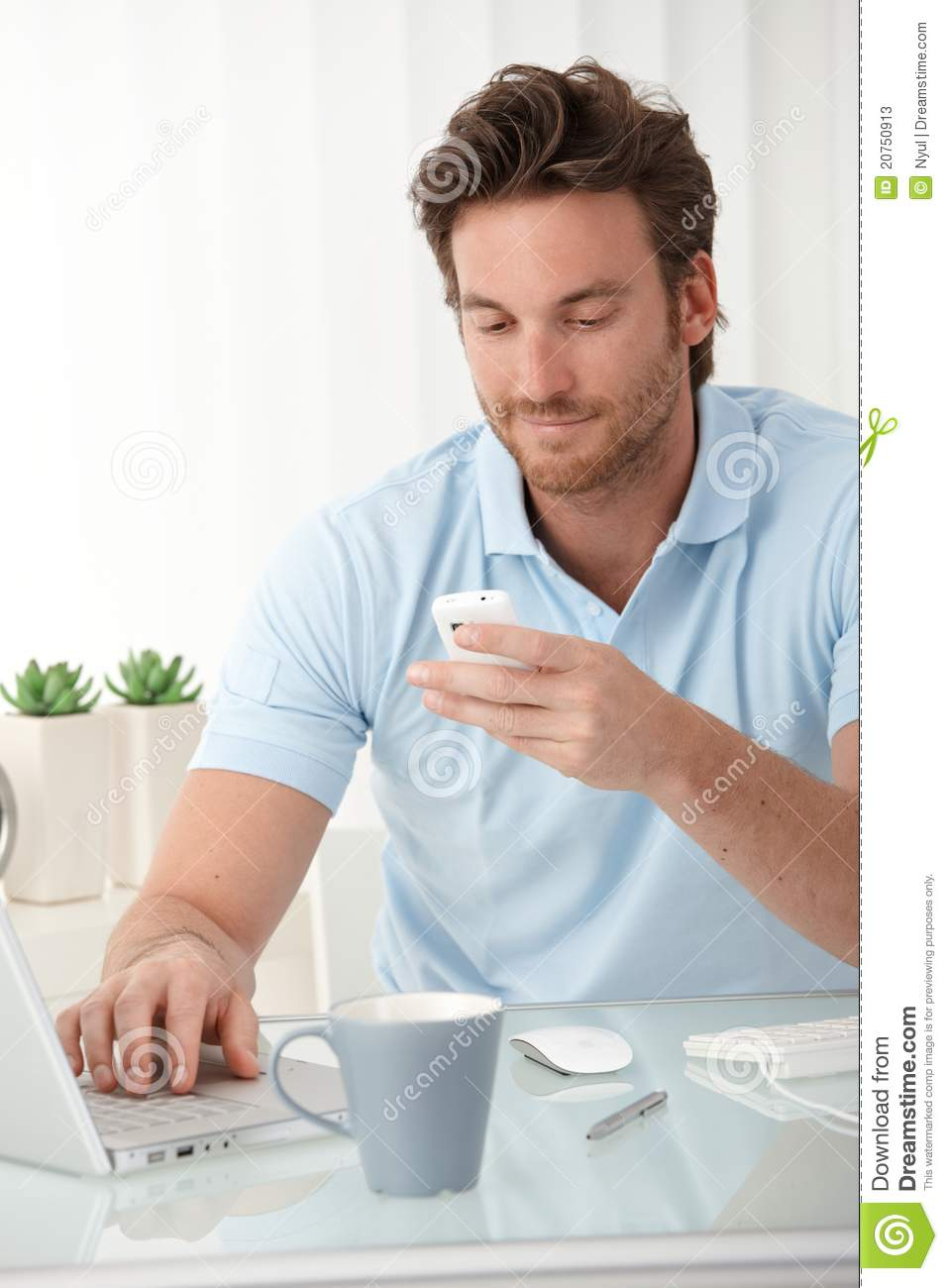 Man On Cell Phone : Smiling man texting on mobile phone stock photos image