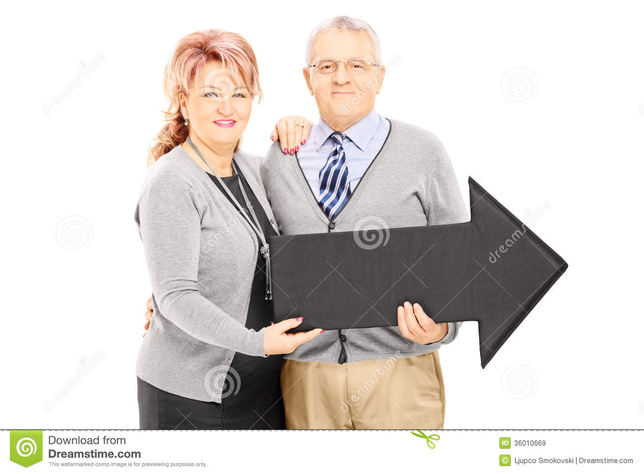 Smiling Mature Man And Woman Holding A Big Arrow Pointing Right Stock Image - Image Of -5578
