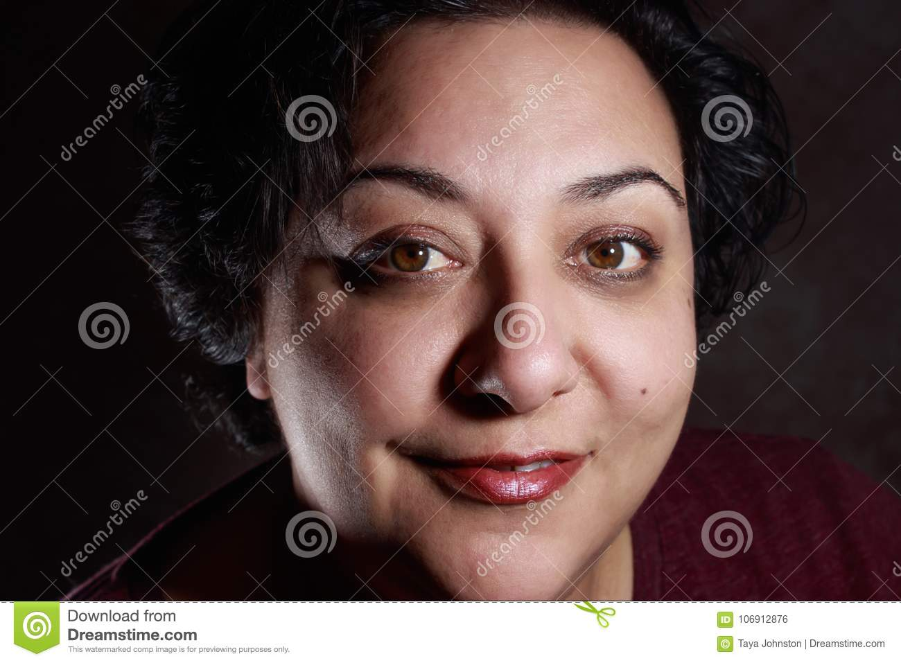 smiling mature mixed race woman wearing short hairstyle