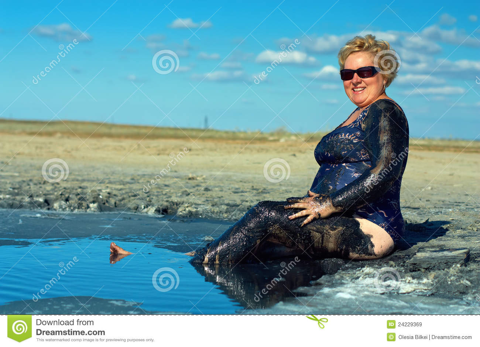 smiling mature plump woman taking mud treatment stock image - image