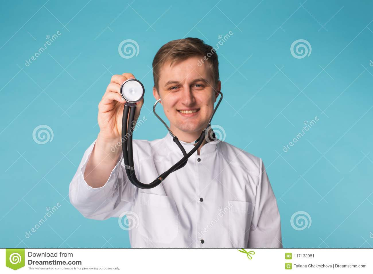 Smiling medical doctor man with stethoscope over blue background with copy space