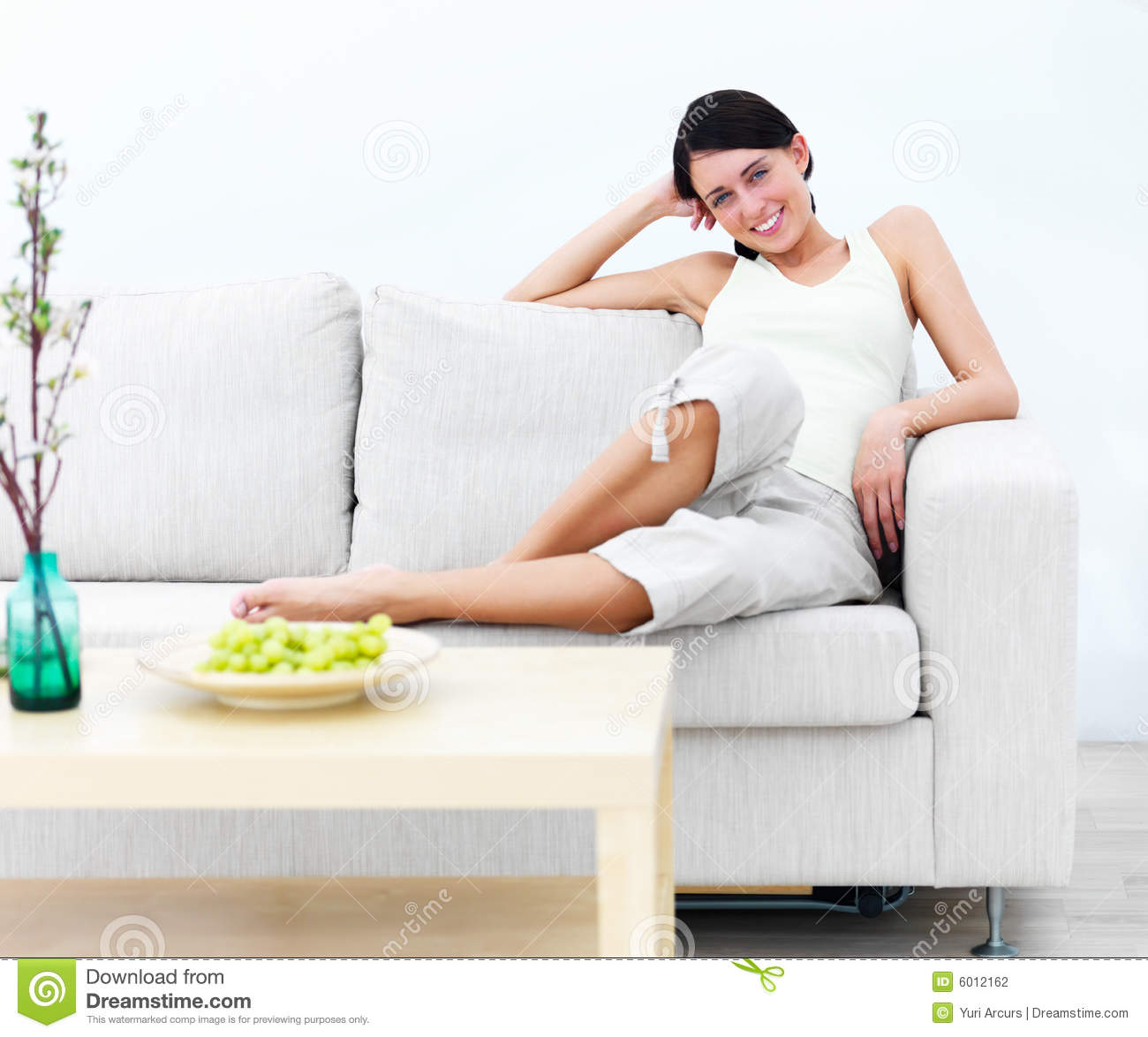 stock photography smiling modern happy young woman On modern sitting