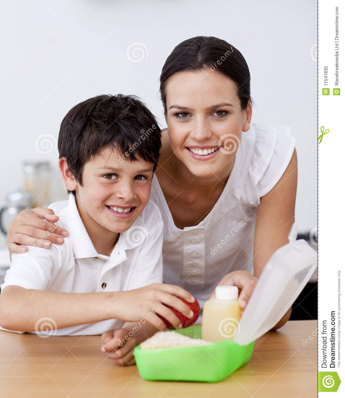 Smiling mother and son making the school lunch