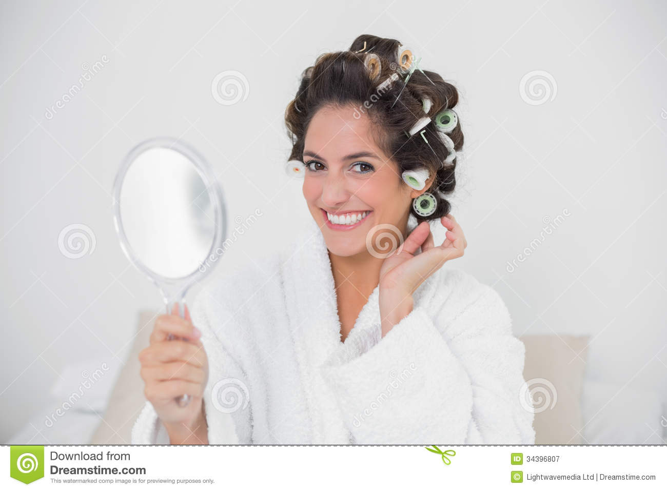 Smiling Natural Brunette Holding Hand Mirror Stock Image