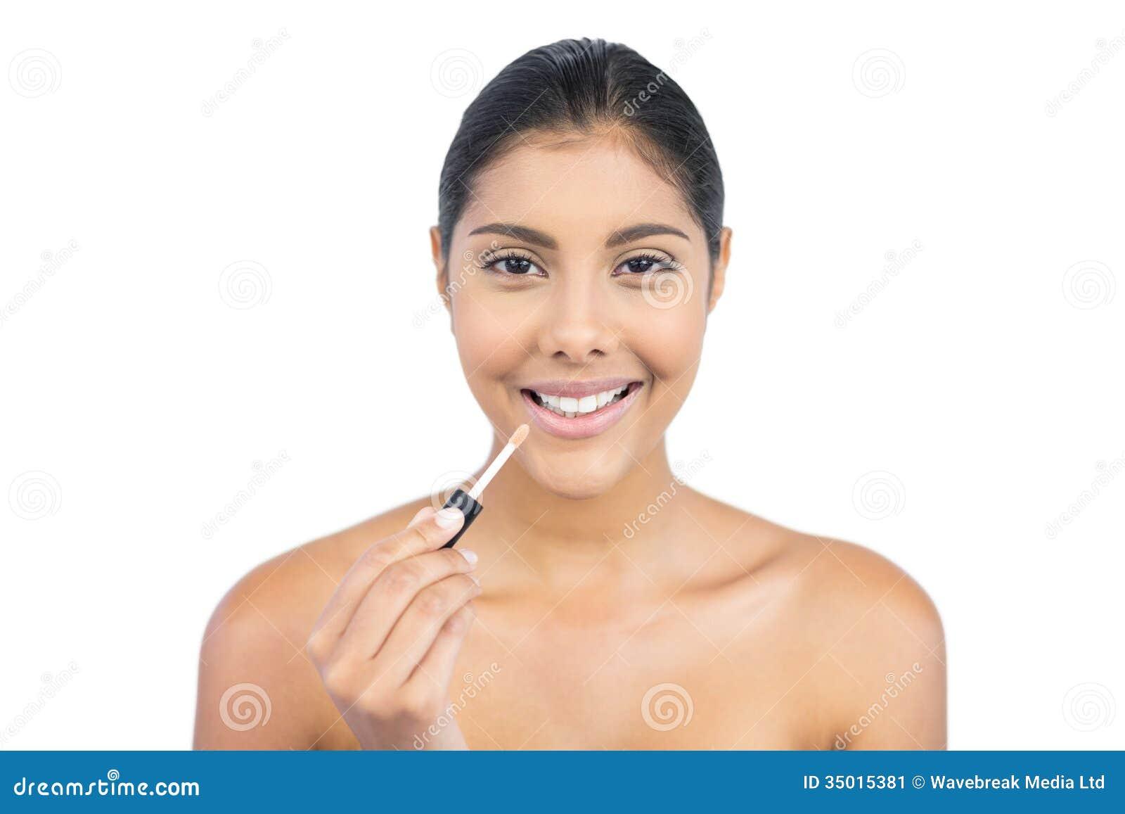 Smiling Nude Brunette Holding Lip Gloss Stock Image